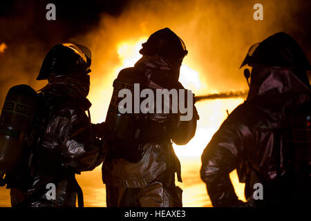 U.S. Air Force firefighters from the 433rd Civil Engineering Squadron, Lackland Air Force Base, Texas and the 512th - Stock Photo