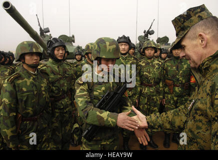 Chairman of the Joint Chiefs of Staff, Marine Gen. Peter Pace,  shakes hands with Chinese tanker soldiers with the - Stock Photo