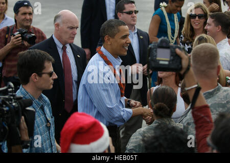 HICKAM AFB,  - President of the United States Barack Obama is greeted by Airmen and their families upon his arrival - Stock Photo