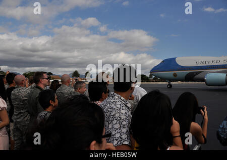 HICKAM AFB,  - Airmen and their families  patiently wait for the door to Air Force One to open so they can take - Stock Photo