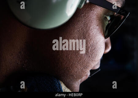 Senior Airman Darhon Hambrick, a boom operator assigned to the 340th Expeditionary Air Refueling Squadron, communicates - Stock Photo