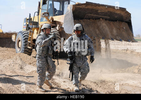 U.S. Navy Lt. j.g. John Victoria, an engineer with the Farah Provincial Reconstruction Team (PRT), explains to U.S. - Stock Photo
