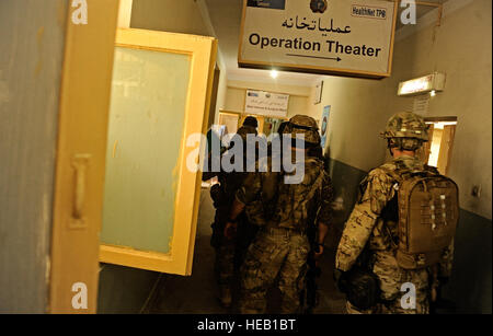 Medical technicians attached to Laghman Provincial Reconstruction Team tour the operating building at the Mehtar - Stock Photo