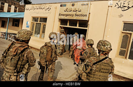Medical technicians attached to Laghman Provincial Reconstruction Team enter the emergency care building at the - Stock Photo