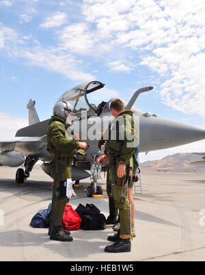 French air force pilots discuss their flight upon arriving at Nellis Air Force Base, Nev., on Aug. 7.  The French - Stock Photo
