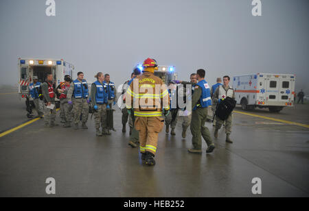 Medical personnel arrive at the scene of a simulated aircraft crash to assist with caring for wounded during the - Stock Photo