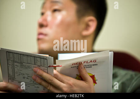 Republic of Korean Air Force 1st Lt. Lee Jung-Hyun, F-15 Strike Eagle pilot, discusses the Red Flag supplement guide - Stock Photo