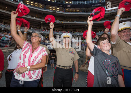 Commandant of the Marine Corps Gen. Robert B. Neller waves his hat during a baseball game at Nationals Park, Washington, - Stock Photo