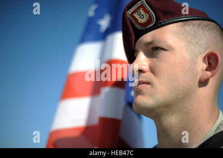U.S. Army Sgt. Matthew Henry, a paratrooper from the 173rd Infantry Brigade Combat Team (Airborne) stands in formation - Stock Photo