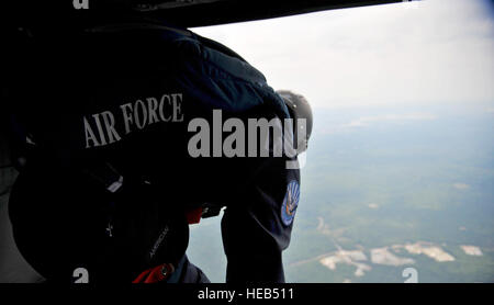 Cadet Jesse Galt, a member of the U.S. Air Force Academy Wings of Blue Jump Team, prepares to jump from a U.S. Army - Stock Photo