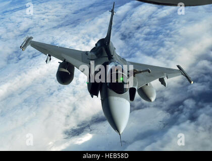 A Swedish JAS-39 Gripen returns to the play areas of the Arctic Challenge exercise Sept. 24, 2013, over Norway, - Stock Photo