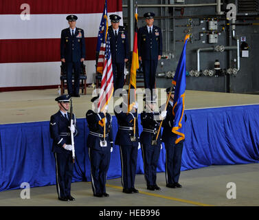 The base honor guard posts the colors during a change of command ceremony June 19, 2015, at Ramstein Air Base, Germany. - Stock Photo