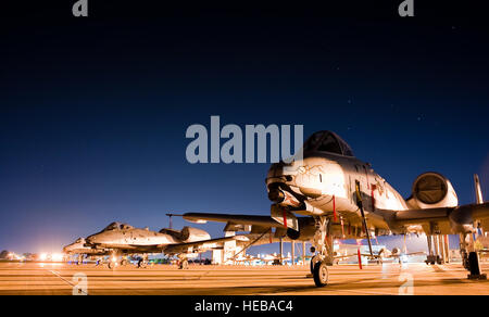 An A-10C Warthog from the 122nd Fighter Wing, Fort Wayne, Ind., sits under a star filled sky after completing a - Stock Photo
