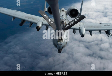 A KC-135 Stratotanker from the 100th Air Refueling Wing refuels a 354th Expeditionary Fighter Squadron A-10 Thunderbolt - Stock Photo