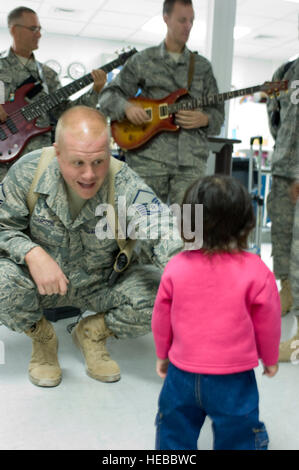 BAGRAM AIR FIELD, Afghanistan -- Master Sgt. Ryan Carson, lead male vocalist for U.S. Air Forces Central band 'Yuma,' - Stock Photo