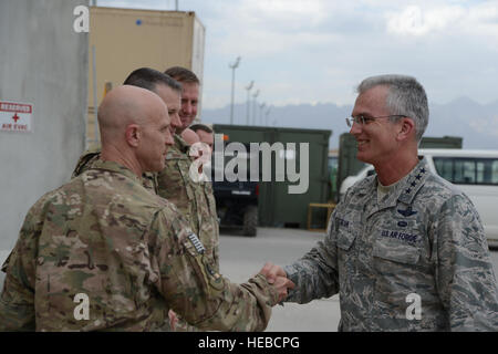 U.S. Air Force Gen. Paul J. Selva, United States Transportation Command commander shakes hands with U.S. Air Force - Stock Photo