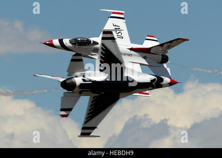 U.S. Air Force Maj's. Blaine Jones, Thunderbird 5, Lead Solo and Jason Curtis, Thunderbird 6, Opposing Solo, perform - Stock Photo