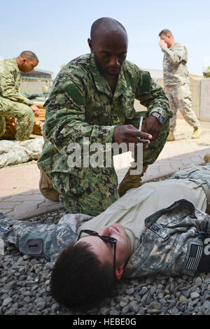 U.S. Navy Petty Officer 2nd Class Fred Turner, a hospital corpsman with the command tactical group, prepares to - Stock Photo