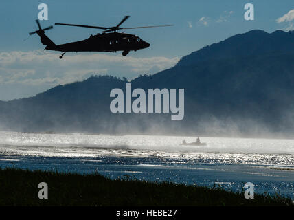 A UH-60 Black Hawk helicopter assigned to the 1-228th Aviation Regiment hovers over U.S. Army Special Operations - Stock Photo