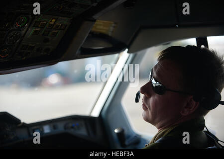 Royal Canadian Air Force Capt. Marc Andre Asselin, a CC-150T pilot, conducts pre-flight checks before take off in - Stock Photo