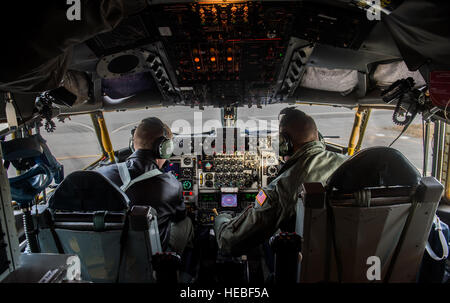 Capt. Nate Williams, aircraft commander, and 1st Lt. Travis Minto, both from the 92nd Aerial Refueling Squadron, - Stock Photo