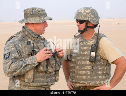 SOUTHWEST ASIA -- Tech. Sgt. Brent Stiefel, 386th Expeditionary Security Forces Squadron Viper team leader, left, - Stock Photo