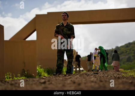 A role player acting as an Afghan National Army soldier greets U.S. soldiers from Charlie Company, 1st Battalion, - Stock Photo