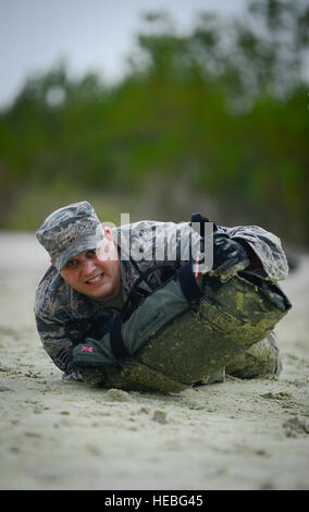Staff Sgt. James Matheny, Joint Communications Support Element cyber transport craftsman, low crawls during a physical - Stock Photo