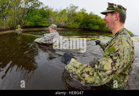 Members from the Joint Communications Support Element cross an inlet on MacDill Air Force Base, Fla., March 2, 2015. - Stock Photo