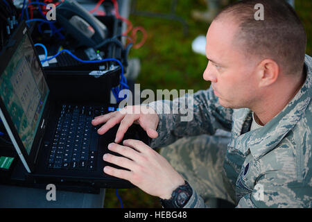 Senior Airman Rob Carlisto, Joint Communications Support Element cyber support, establishes communications during - Stock Photo