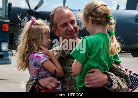 California Air National Guardsmen assigned to the 129th Rescue Wing arrive home June 11, 2013, at Moffett Federal - Stock Photo