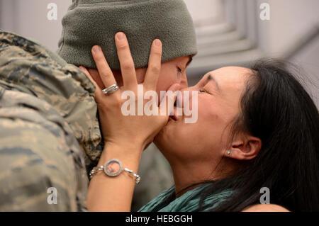 Capt. Joe Faraone reunites with his wife, Suk, Jan. 15, 2014, at Spangdahlem Air Base, Germany, The Airman returned - Stock Photo