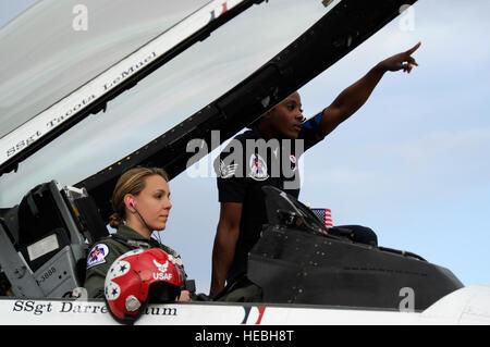 Staff Sgt. Tacota LeMuel, Thunderbird 3 dedicated crew chief, signals one-minute, in preparation for Maj. Caroline - Stock Photo