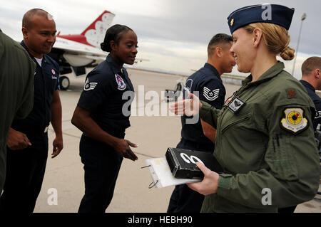 Maj. Caroline Jensen, Thunderbird 3, Right Wing pilot, is greeted by her dedicated crew chief, Staff Sgt. Tacota - Stock Photo