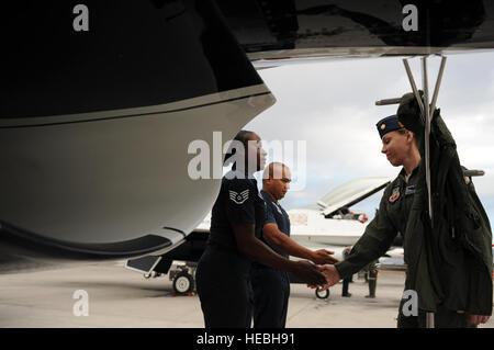 Maj. Caroline Jensen, Thunderbird 3, Right Wing pilot, is greeted by Staff Sgt. Tacota LeMuel, Thunderbird 3 dedicated - Stock Photo