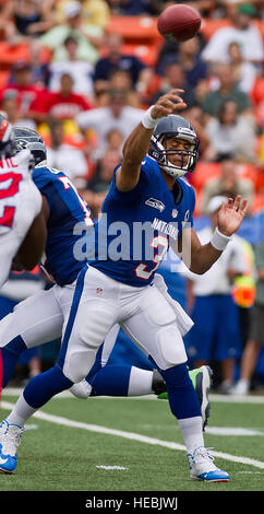 Seattle Seahawks quarterback Russell Wilson throw a pass toward the end zone during the third quarter of the 2013 - Stock Photo