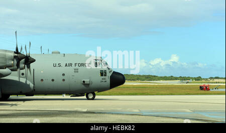 A C-130H, based at Yokota Air Base, Japan, taxis on its way to conduct airdrop operations for Operation Christmas - Stock Photo
