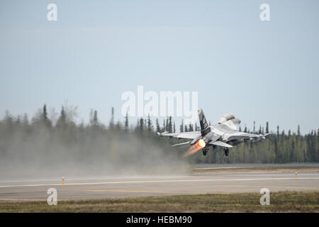 An F-16 Fighting Falcon assigned to the 18th Aggressor Squadron takes off during Red Flag Alaska 14, May 13, 2014, - Stock Photo