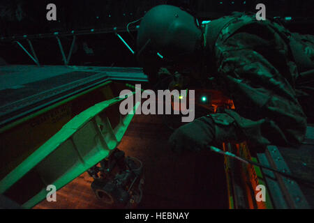 U.S. Army Spc. Ryan Bragg prepares to navigate the pilot over the soldiers, assigned to the 1569th Transportation - Stock Photo