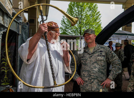 An Explore the Eifel exhibitor, left, showcases a horn to U.S. Air Force Col. Joe McFall, 52nd Fighter Wing commander, - Stock Photo