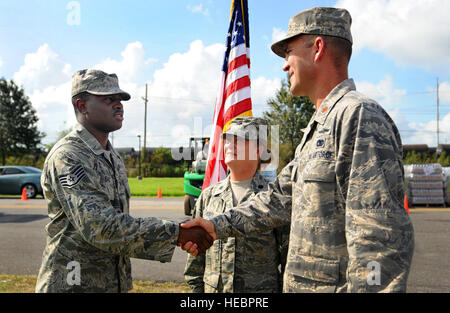 METAIRIE, La – Staff Sgt. Kelvin Isaac, 159th Medical Group,  is congratulated by Maj Todd Hubbell, 214th Engineering - Stock Photo