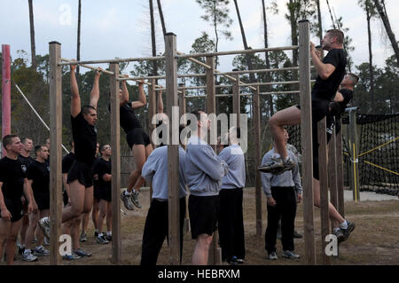 Tactical Air Control Party candidates doing pull-ups as part of their morning workout routine March 25, 2010, Hurlburt - Stock Photo