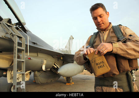 JOINT BASE BALAD, Iraq -- Lt. Col. David Smith, 332nd Expeditionary Fighter Squadron commander, carefully packs - Stock Photo