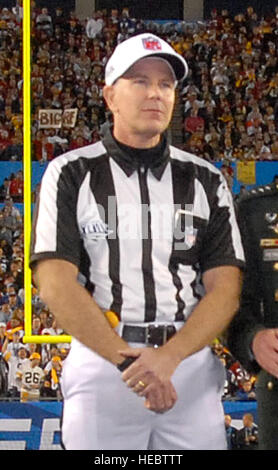 General David H. Petraeus, Commander, United Staes Central Command, talks with head Super Bowl XLIII Referee, Terry McAulay prior to the coin toss Feb. , at Raymond James Stadium in Tampa Fla.   (USAF Photo By SSgt bradley Lail) (released)