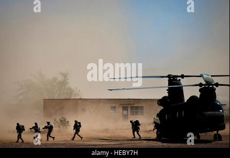 Marines from the 2nd Force Reconnaissance Company evacuate a CH-47 Chinook during an urban environment warfare exercise - Stock Photo