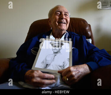 Retired Col. Ralph Parr holds a portrait of himself as he looks toward the window of his room. Parr joined the Army - Stock Photo