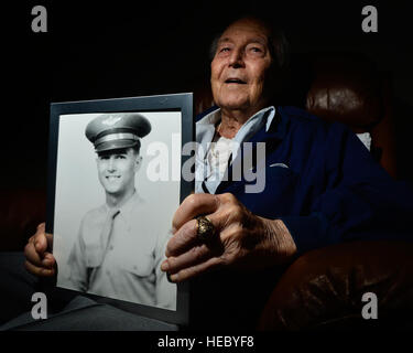 Col. Ralph Parr, U.S. Air Force (Retired), holds a portrait of himself as he reflects on his military career during - Stock Photo