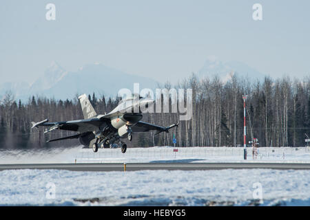 An F-16 Fighting Falcon takes off during a training sortie April 3, 2014 at Eielson Air Force Base, Alaska. Regular - Stock Photo