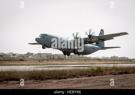 A U.S. Air Force C-130 Hercules takes off from Léopold Sédar Senghor International Airport in Dakar, Senegal, Nov. - Stock Photo