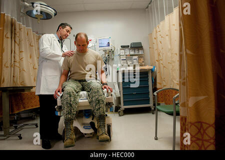 Sean Harap, Tripler Army Medical Center physician, performs a physical exam for U.S. Air Force Capt. Joshua Gscheidmeier, - Stock Photo